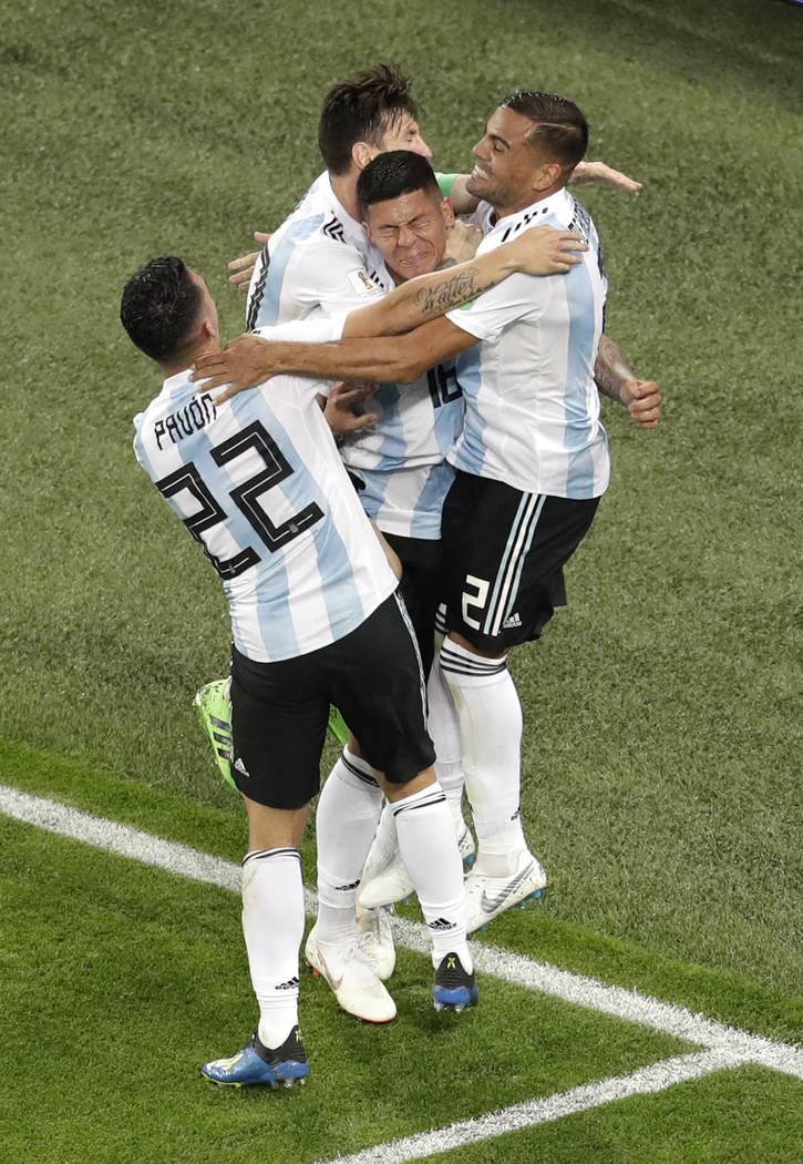 Argentina's Marcos Rojo, center, celebrates with teammate Lionel Messi after scoring his side's second goal during the group D match between Argentina and Nigeria, at the 2018 soccer World Cup in ...
