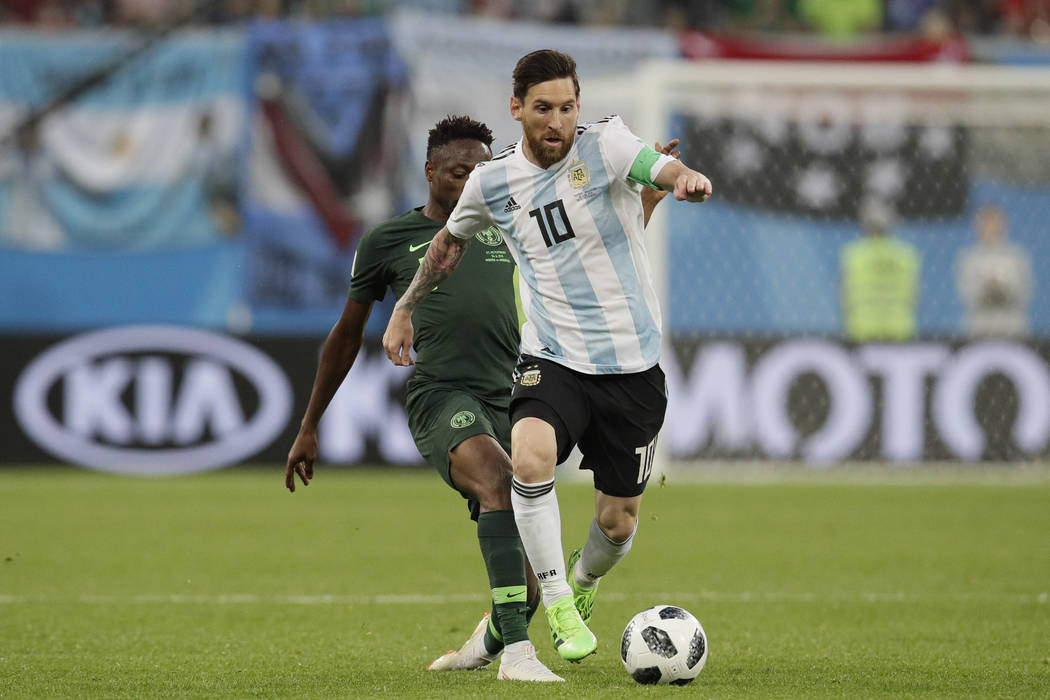 Argentina's Lionel Messi, front, competes for the ball during the group D match between Argentina and Nigeria at the 2018 soccer World Cup in the St. Petersburg Stadium in St. Petersburg, Russia, ...
