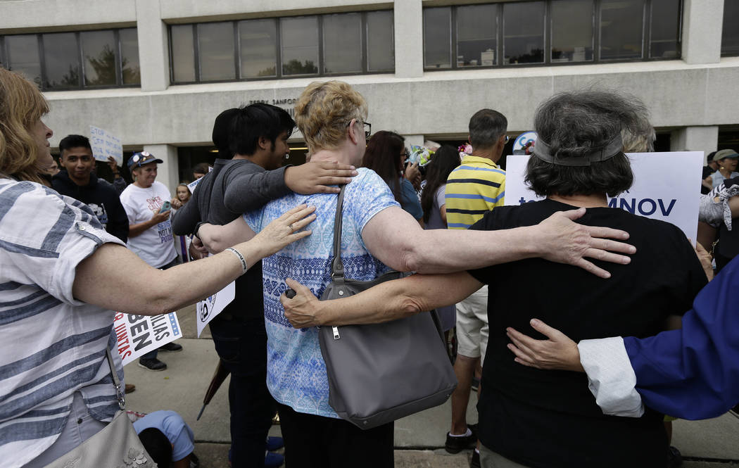 Activists with Tuesdays with Tillis rally outside U.S. Sen. Tom Tillis' office at the Federal Building to demand the reunification of families torn apart by separating families at the border, Tues ...