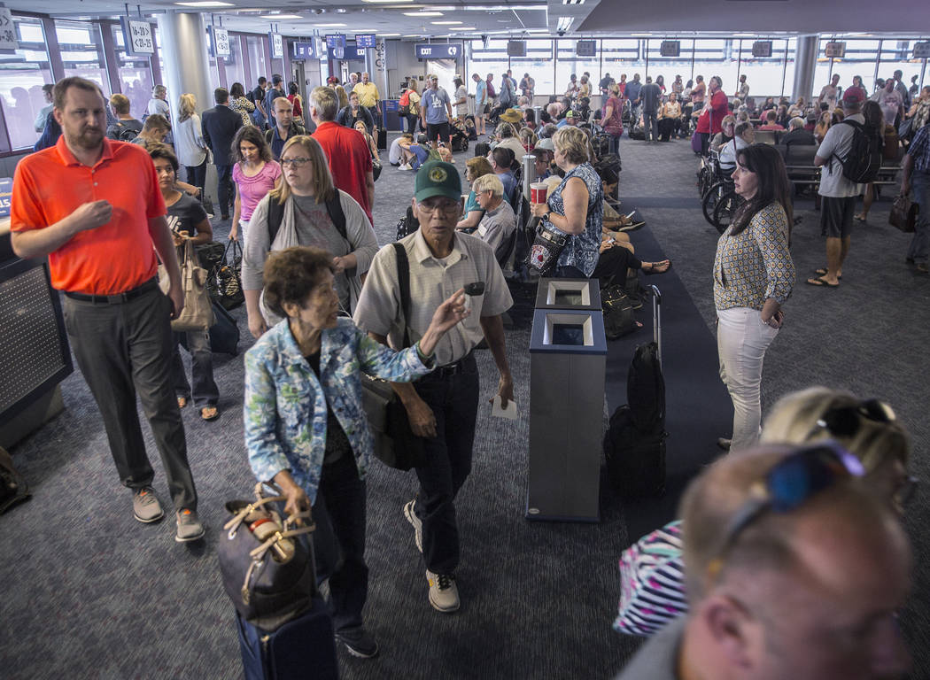 Passengers arrive from their Southwest flight at Gate D in Terminal 1 at McCarran International Airport on Thursday, June 28, 2018, in Las Vegas. Benjamin Hager Las Vegas Review-Journal @benjaminh ...
