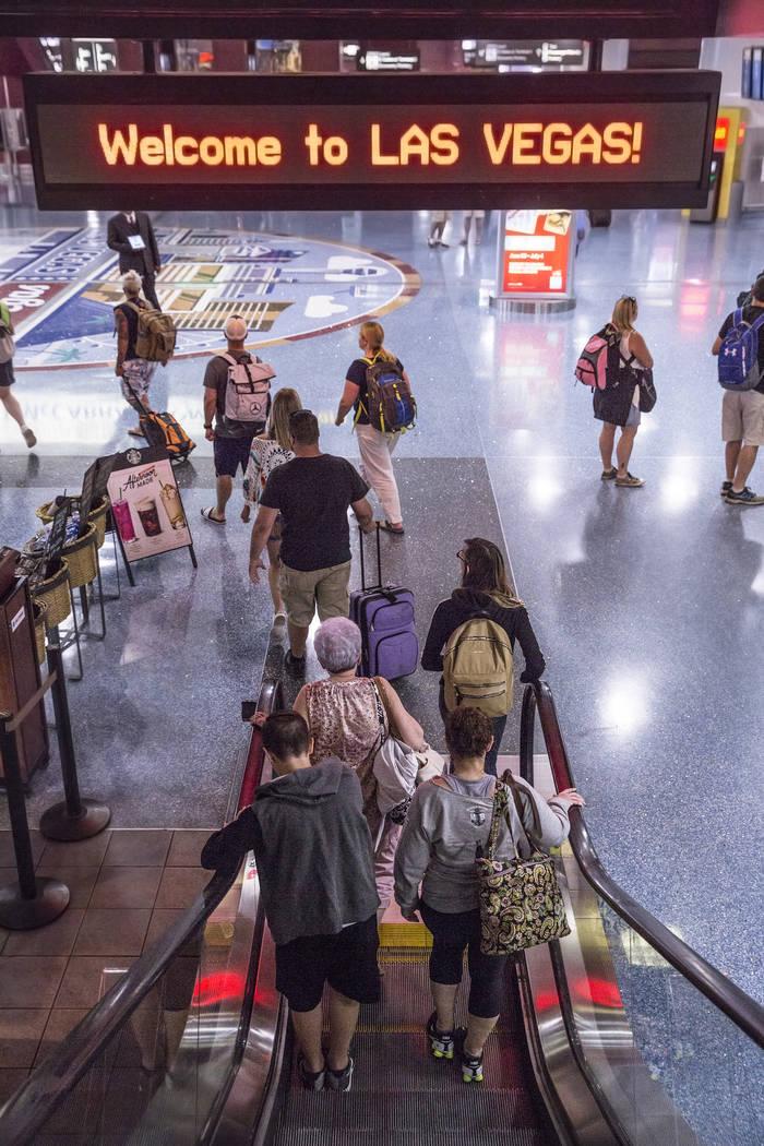 Passengers take the escalator to Terminal 1 baggage claim at McCarran International Airport on Thursday, June 28, 2018, in Las Vegas. Benjamin Hager Las Vegas Review-Journal @benjaminhphoto