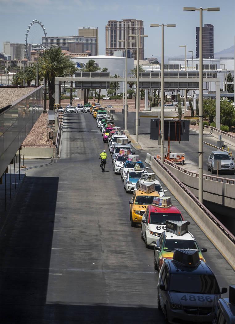 Taxis wait outside Terminal 1 at McCarran International Airport on Thursday, June 28, 2018, in Las Vegas. Benjamin Hager Las Vegas Review-Journal @benjaminhphoto