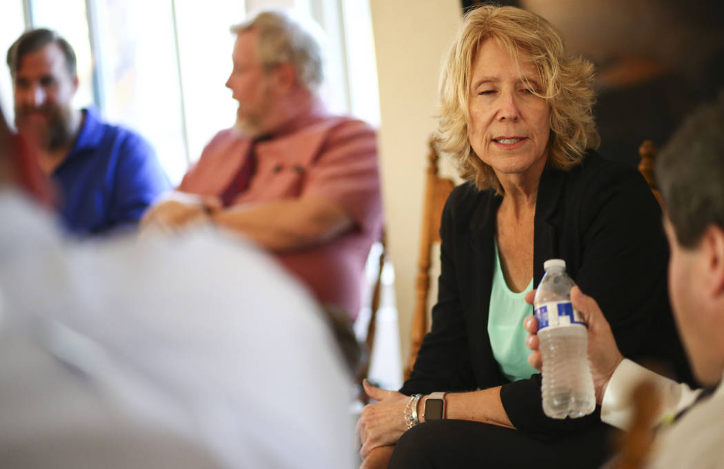 Clark County Education Association President Vikki Courtney, a member of the election slate Educators for Progress, talks with fellow slate members while meeting at the home of member Theo Small, ...