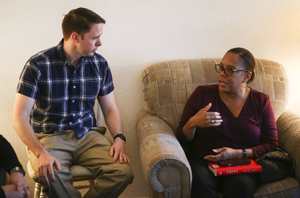Jeremy Campf, left, and Yolanda Lowry, both members of the Clark County Education Association election slate known as Educators for Progress, meet at the home of member Theo Small, the current CCE ...
