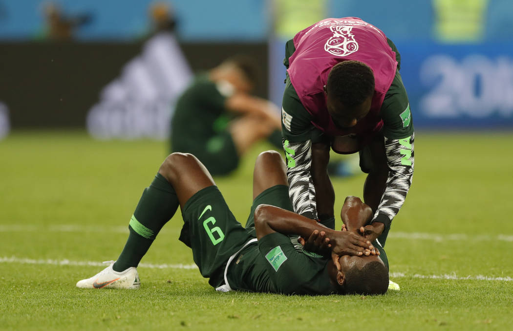 Nigeria's Odion Ighalo cries at the end of the group D match between Argentina and Nigeria, at the 2018 soccer World Cup in the St. Petersburg Stadium in St. Petersburg, Russia, Tuesday, June 26, ...
