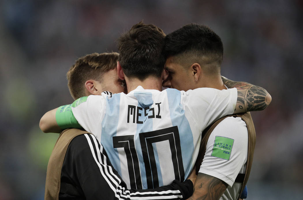 Argentina's Lionel Messi react with his teammates during the group D match between Argentina and Nigeria at the 2018 soccer World Cup in the St. Petersburg Stadium in St. Petersburg, Russia, Tuesd ...