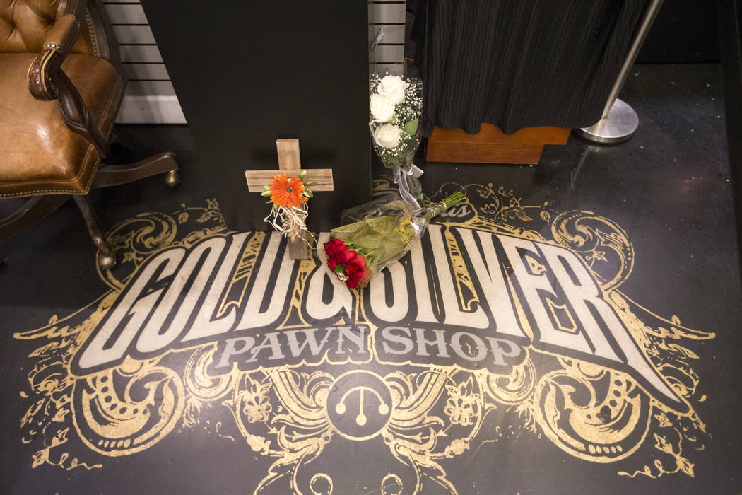 "Mementos sit on the floor at a makeshift memorial for Richard Benjamin Harrison, better known as ""The Old Man"" on A&E's reality television series ""Pawn Stars,"" in the back ..."