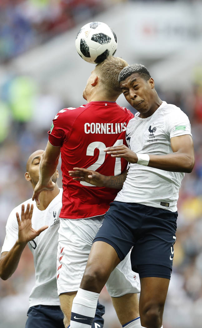 Denmark's Andreas Cornelius goes for a header with France's Presnel Kimpembe during the group C match between Denmark and France at the 2018 soccer World Cup at the Luzhniki Stadium in Moscow, Rus ...