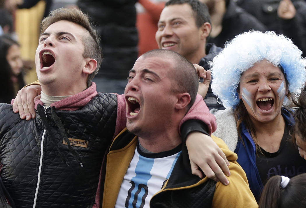 Argentina soccer fans celebrate a goal by Marcos Rojo during a live broadcast of the Russia 2018 World Cup soccer match against Nigeria, in Buenos Aires, Argentina, Tuesday, June 26, 2018. (AP Pho ...