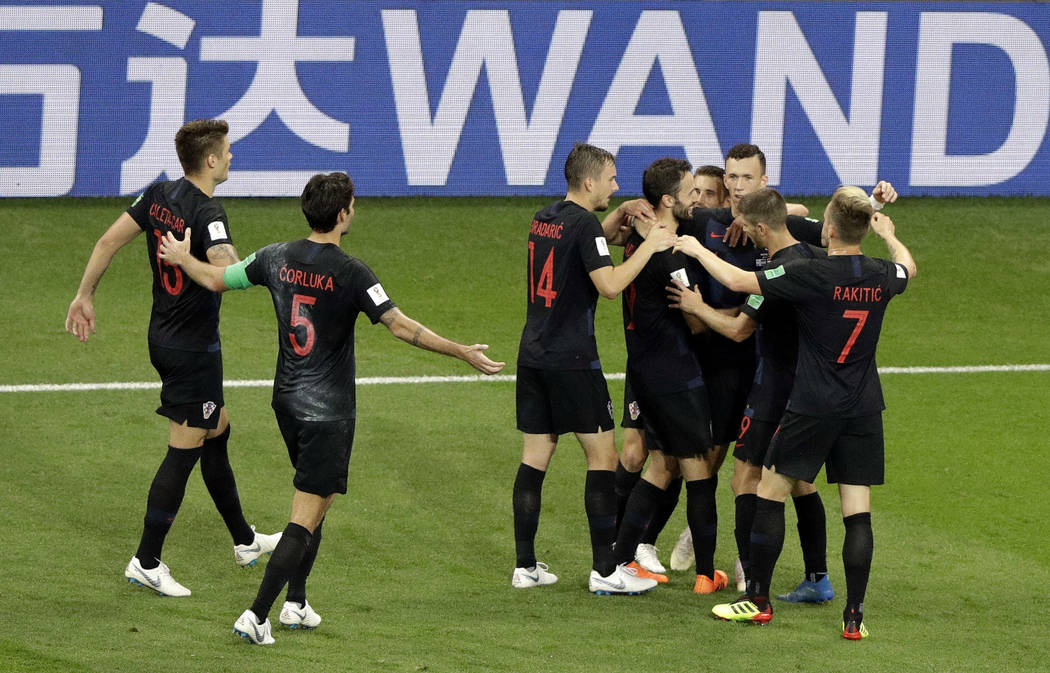 Croatia's players celebrates with teammate Ivan Perisic after scoring his side winning goal during the group D match between Iceland and Croatia, at the 2018 soccer World Cup in the Rostov Arena i ...