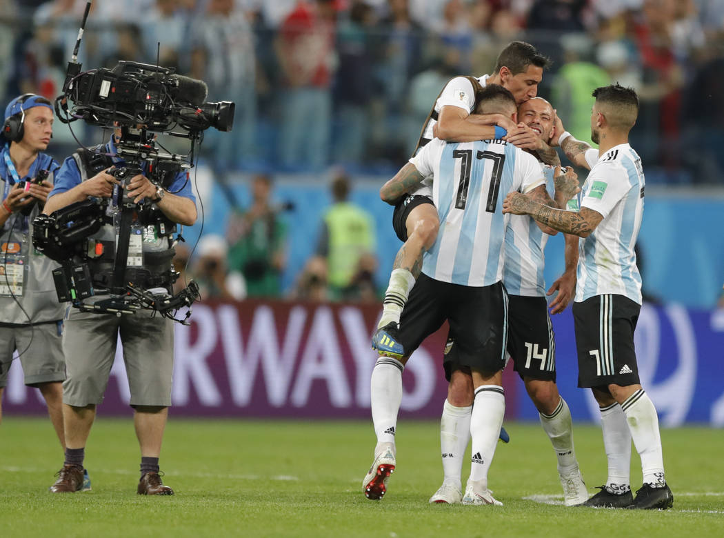 Argentina players celebrate at the end of the group D match between Argentina and Nigeria, at the 2018 soccer World Cup in the St. Petersburg Stadium in St. Petersburg, Russia, Tuesday, June 26, 2 ...