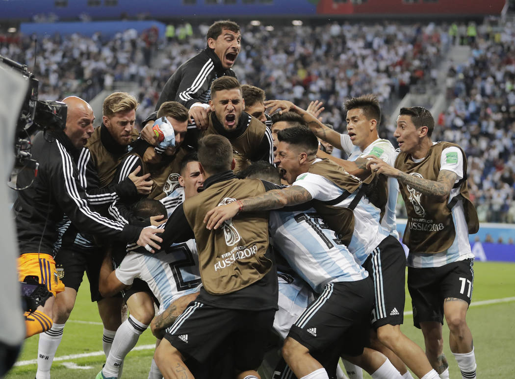 Argentina players celebrates his side's second goal by Argentina's Marcos Rojo during the group D match between Argentina and Nigeria at the 2018 soccer World Cup in the St. Petersburg Stadium in ...