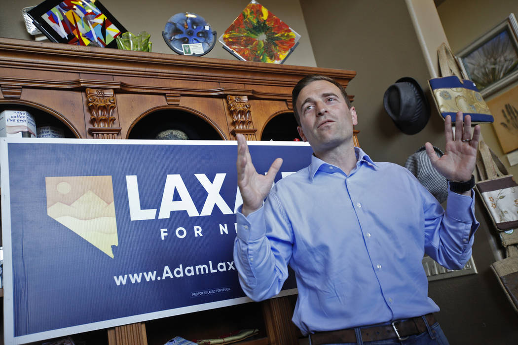 """Adam Laxalt, a Republican running for Governor, speaks to the crowd at a """"Get-Out-The-Vote"""" campaign at Avery's Coffee Shop in Las Vegas, Wednesday, May 30, 2018. (Rachel Aston Las Vegas Review-J ..."""