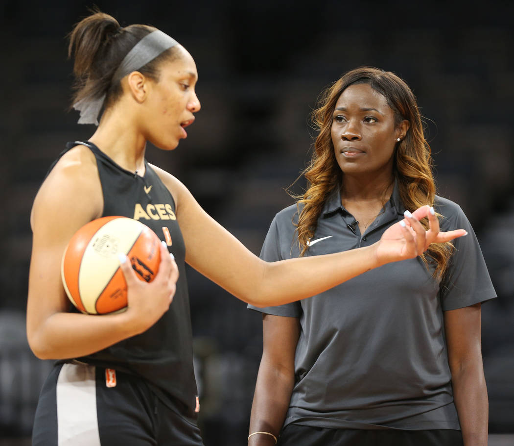 Las Vegas Aces's commentator Rushia Brown, right, speaks to center A'ja Wilson during a team practice at the Mandalay Bay Events Center in Las Vegas, Tuesday, June 26, 2018. Erik Verduzco Las Vega ...