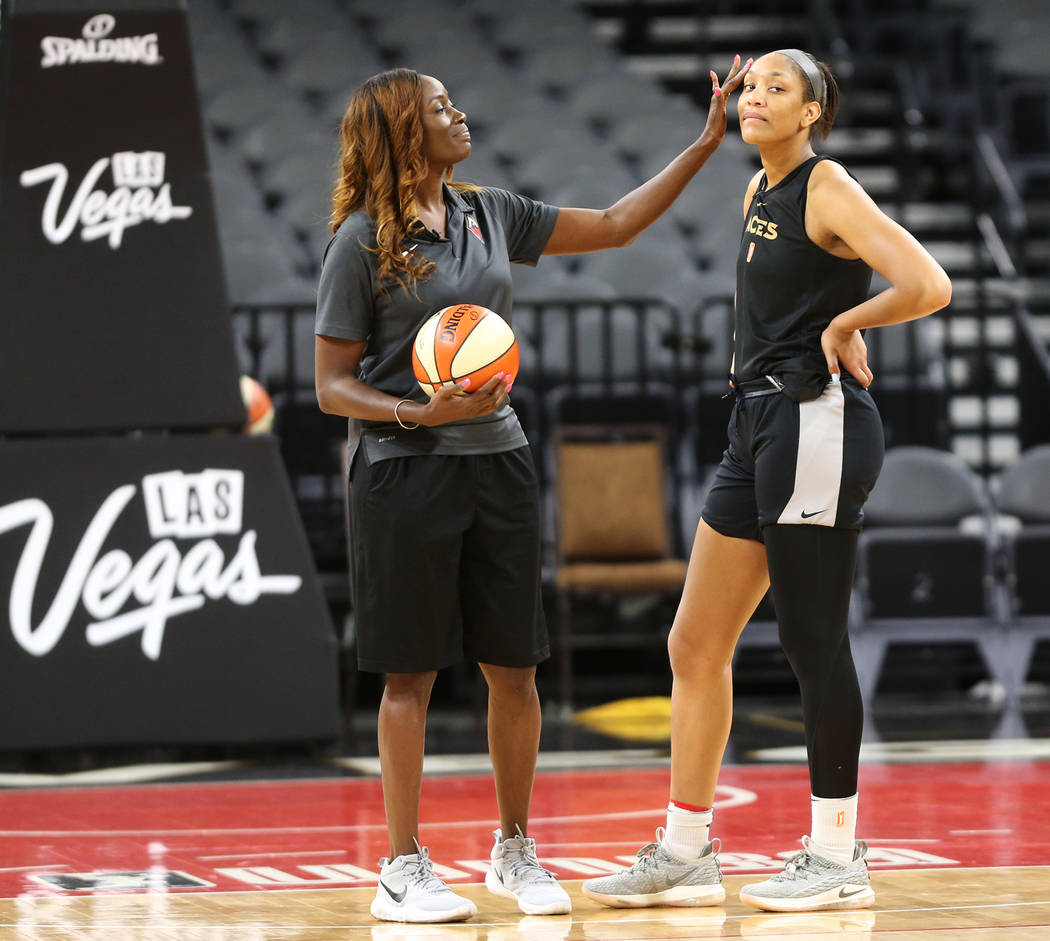 Las Vegas Aces's commentator Rushia Brown, left, speaks to center A'ja Wilson during a team practice at the Mandalay Bay Events Center in Las Vegas, Tuesday, June 26, 2018. Erik Verduzco Las Vegas ...