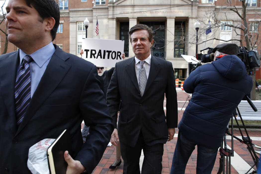 Jason Maloni, left, former Trump campaign chairman Paul Manafort's spokesman, left, walks with Paul Manafort, center, as they leave the Alexandria Federal Courthouse after an arraignment hearing i ...