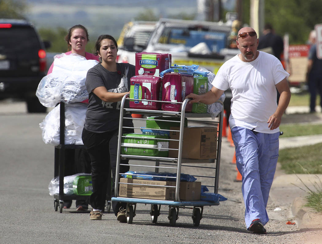 Supplies are shipped from Coryell Memorial Healthcare System hospital to a private car after an explosion in a building under construction at the hospital injured several people, and knocked power ...