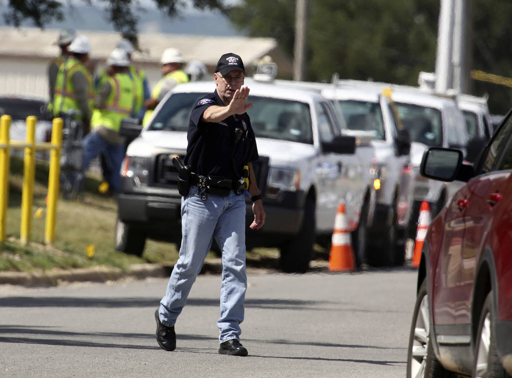 A police officer halts traffic heading to the Coryell Memorial Healthcare System hospital where an a explosion in a building under construction injured several people, and knocked power out for a ...