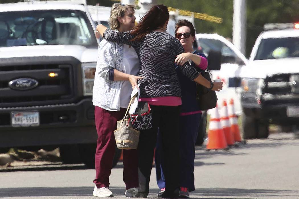 People hug near Coryell Memorial Healthcare System hospital where an explosion in a building under construction injured several people, and knocked power out for a large portion of the city, Tuesd ...