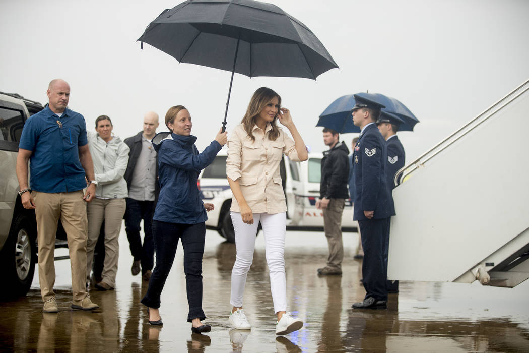 First lady Melania Trump, accompanied by chief of staff Lindsay Reynolds, center left, walks across the tarmac before boarding a plane at McAllen Miller International Airport in McAllen, Texas, Th ...