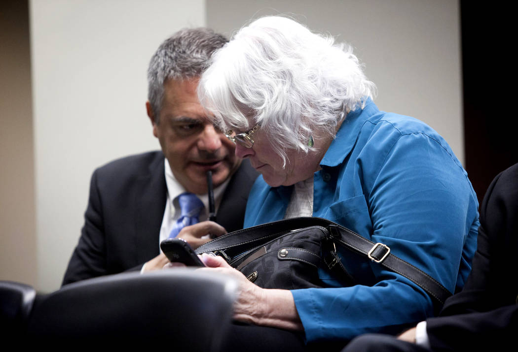 Carolyn Edwards, right, talks with Carlos McDade in this file photo. (Jessica Ebelhar/Las Vegas Review-Journal)