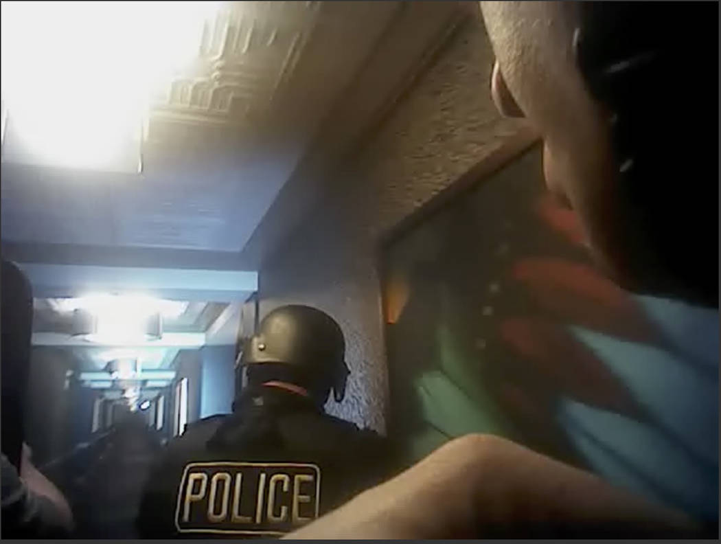 This still image taken from police officer body-camera video footage on Oct. 1, 2017, provided by the Las Vegas Metropolitan Police Department, shows officers searching hallways during the deadlie ...