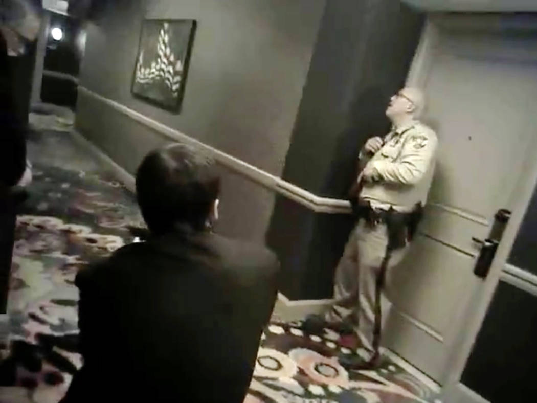 Newly released camera footage shows two Las Vegas police officers, paired with three armed Mandalay Bay security guards, holding their position in a hallway one floor beneath the Oct. 1 gunman for ...