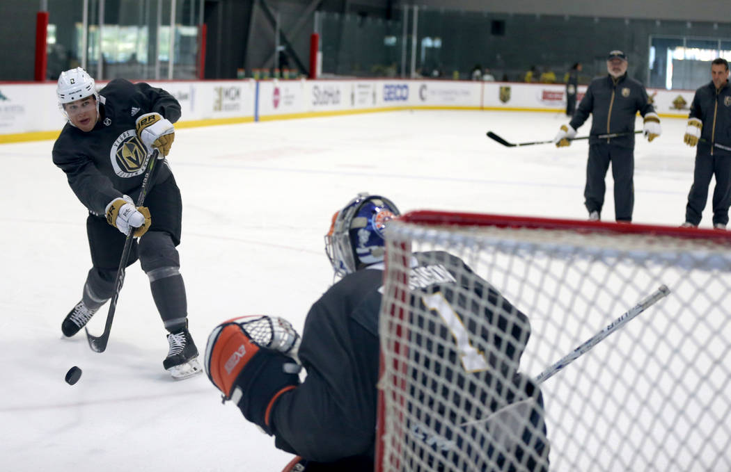 Vegas Golden Knights defender Zach Whitecloud shoots on goaltender Dylan Ferguson during the first day of development camp at City National Arena in Las Vegas Tuesday, June 26, 2018. K.M. Cannon L ...