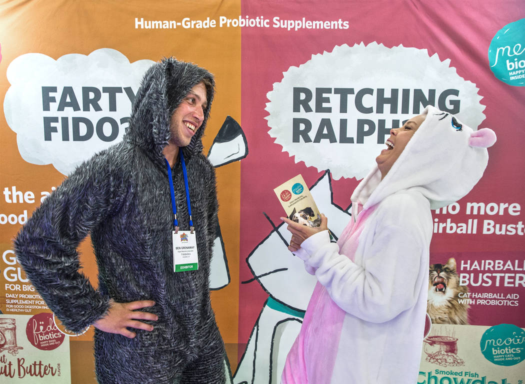 Fidobiotics representatives Ben Grenaway, left, and Mika Wheelwright share a laugh during SuperZoo, an annual trade show for pet retailers at the Mandalay Bay Convention Center on Tuesday, June 26 ...