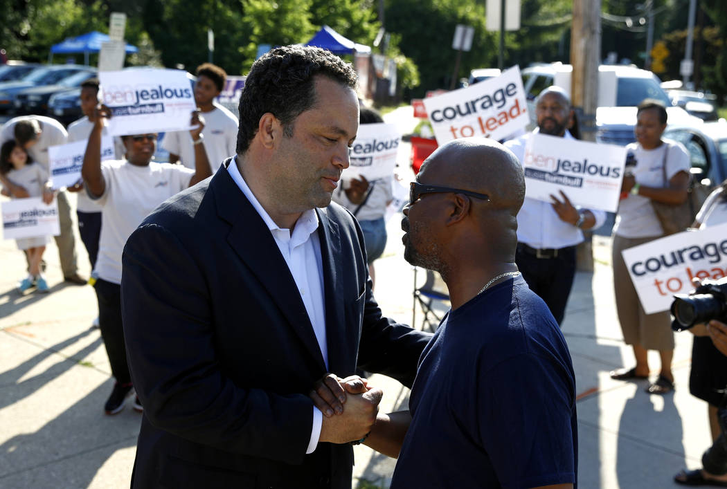 Maryland Democratic gubernatorial candidate Ben Jealous, left, speaks with Alvin Pierce as he greets voters outside a polling place, Tuesday, June 26, 2018, in Baltimore. Jealous and Prince George ...