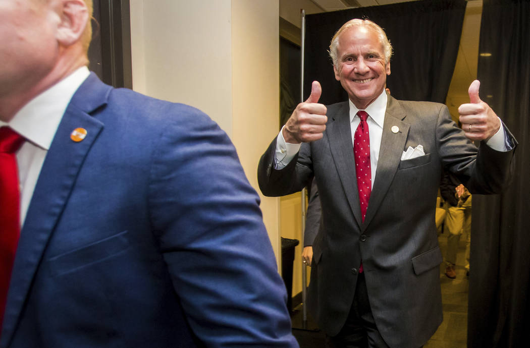 Following his victory in the primary runoff election, South Carolina Gov. Henry McMaster leaves his suite at Spirit Communications Park and heads to the podium speak at his victory party, Tuesday, ...