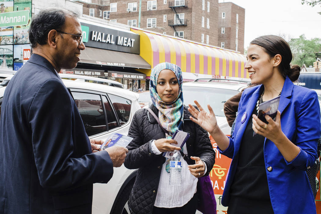 This May 6, 2018 photo provided by the Alexandria Ocasio-Cortez Campaign shows candidate Alexandria Ocasio-Cortez, right, during a Bengali community outreach in New York. Ocasio-Cortez, a 28-year- ...