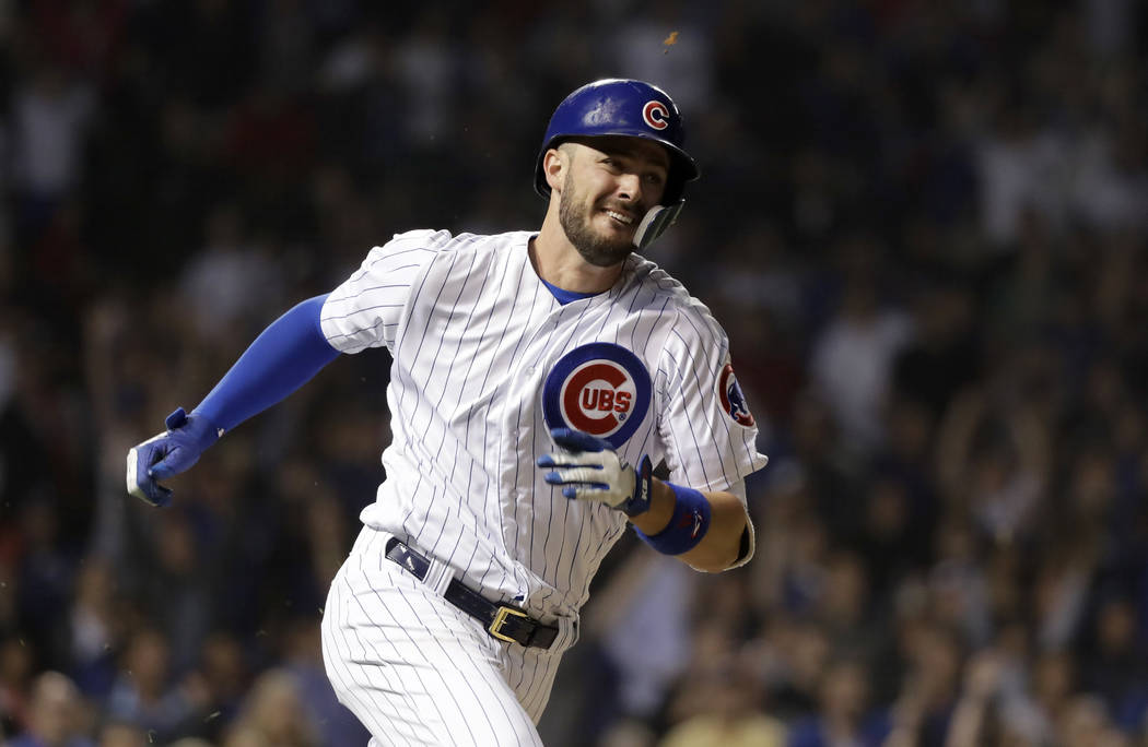 In this June 19, 2018, file photo, Chicago Cubs' Kris Bryant watches his lead-off triple off Los Angeles Dodgers relief pitcher Brock Stewart during the 10th inning of a baseball game in Chicago. ...