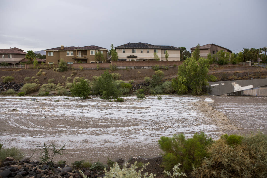 Floodwaters rush through the Pittman Wash in Henderson during a monsoon rainstorm on Wednesday, July 19, 2017. (Patrick Connolly/Las Vegas Review-Journal) @PConnPie