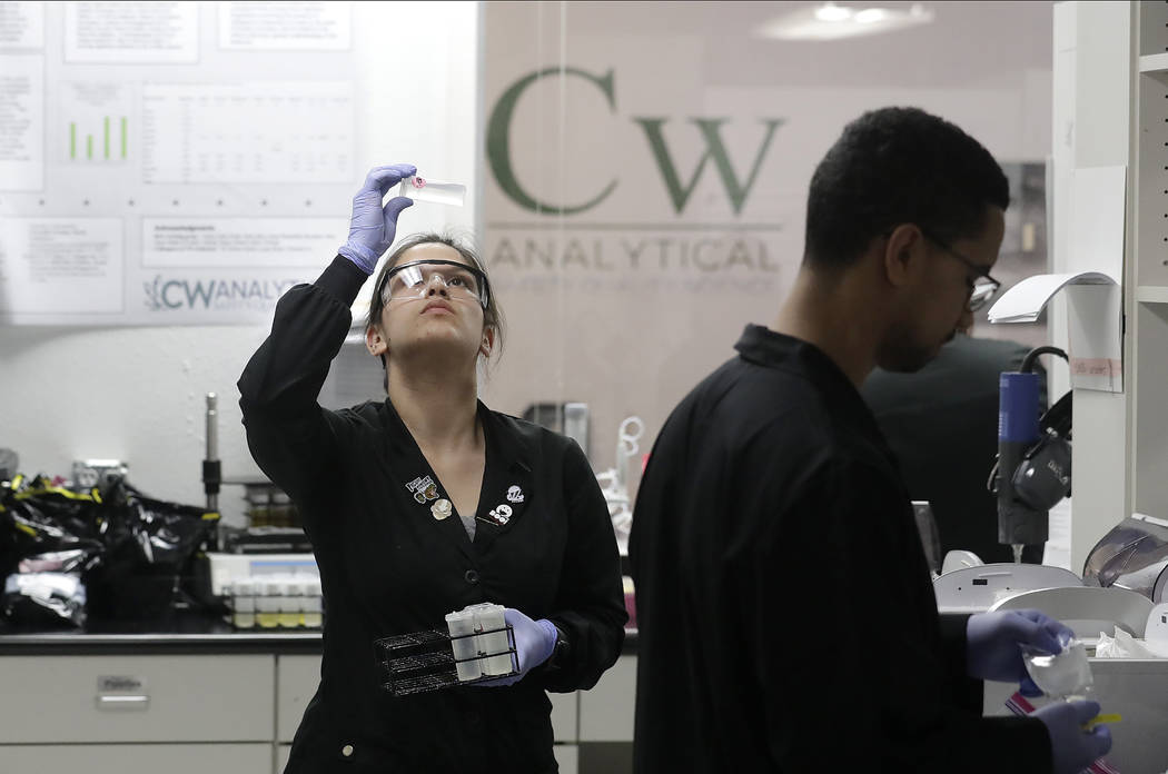 In this June 21, 2018, photo, lab technician Jessica Ibarra, left, and chemist Tommie Griffin work in the lab at CW Analytical Laboratories in Oakland, Calif. California's new rules require testin ...