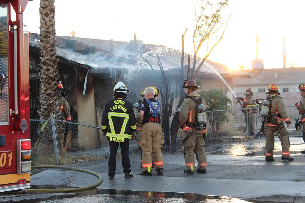 Las Vegas Firefighters Work On A House Fire At 960 G St., Near Washington