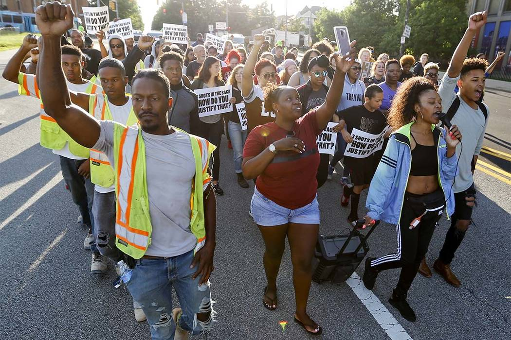 Protesters march in honor of Antwon Rose Jr. on Tuesday, June 26, 2018, in Pittsburgh. Rose was fatally shot by a police officer seconds after he fled a traffic stop June 19, in the suburb of East ...