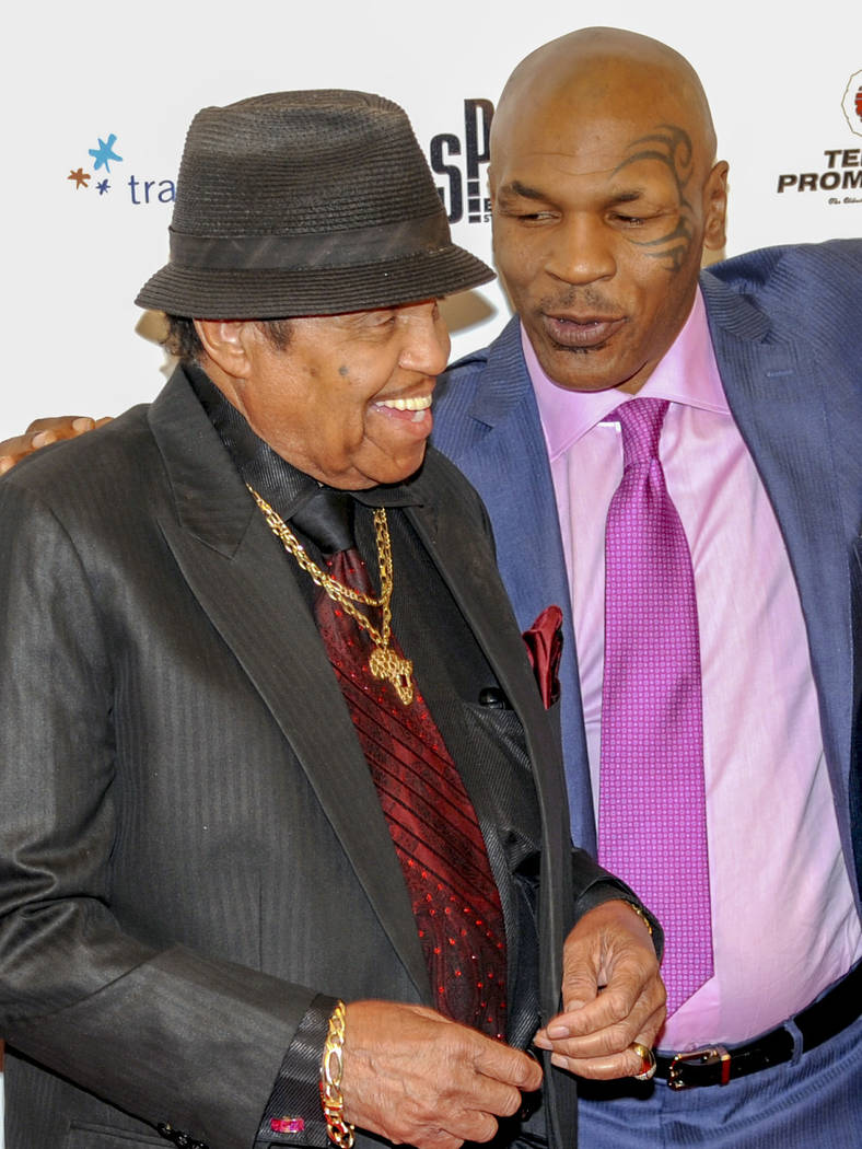 """Joe Jackson with Mike Tyson on the red carpet for the """"Mike Tyson: Undisputed Truth-Live on Stage"""" grand opening show at the MGM Grand on the Las Vegas Strip. Saturday, April 14, 2012. (PGlenn Pin ..."""