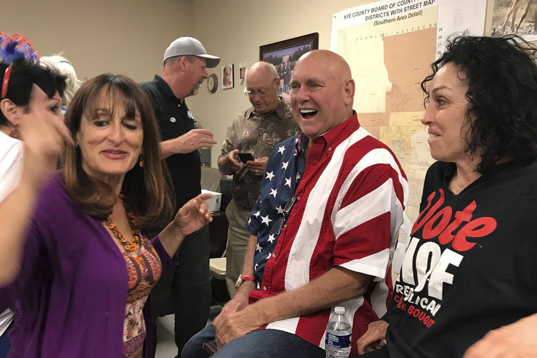 This Tuesday, June 12, 2018 photo shows Nevada brothel owner Dennis Hof, second from right celebrating after winning the primary election in Pahrump, Nev. Hof, the owner of half a dozen legal brot ...