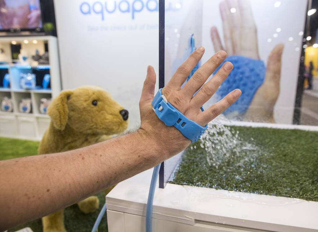 Tom Zipprian demonstrates how to use Aquapaw, a hand-held device that helps bath dogs, during SuperZoo at the Mandalay Bay Convention Center on Tuesday, June 26, 2018, in Las Vegas. Benjamin Hager ...