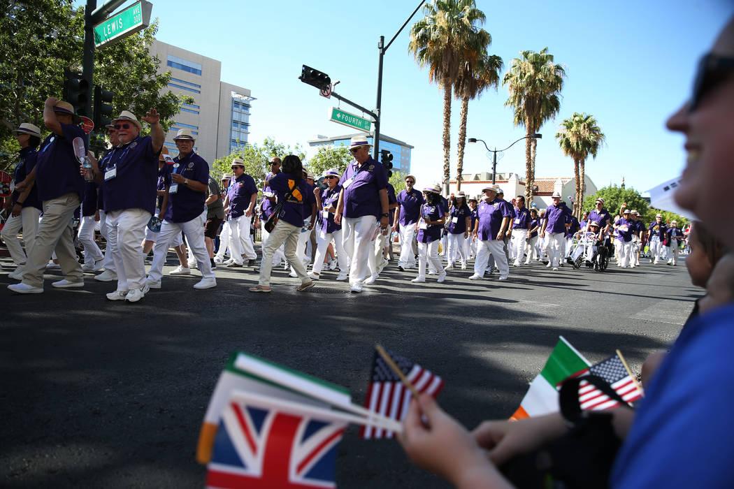 People participate in the Lions Clubs International Parade of Nations on S. 4th Street in Las Vegas, Saturday, June 30, 2018. Erik Verduzco Las Vegas Review-Journal @Erik_Verduzco