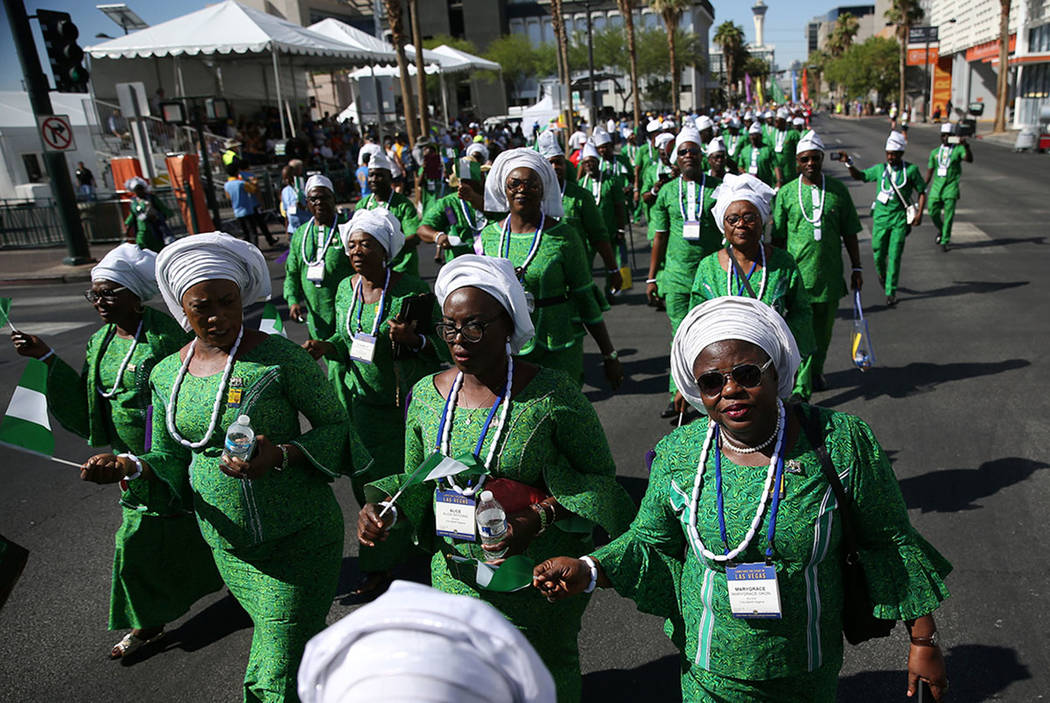 People holding Nigerian flags participate in the Lions Clubs International Parade of Nations on S. 4th Street in Las Vegas, Saturday, June 30, 2018. (Erik Verduzco Las Vegas Review-Journal @Erik_V ...