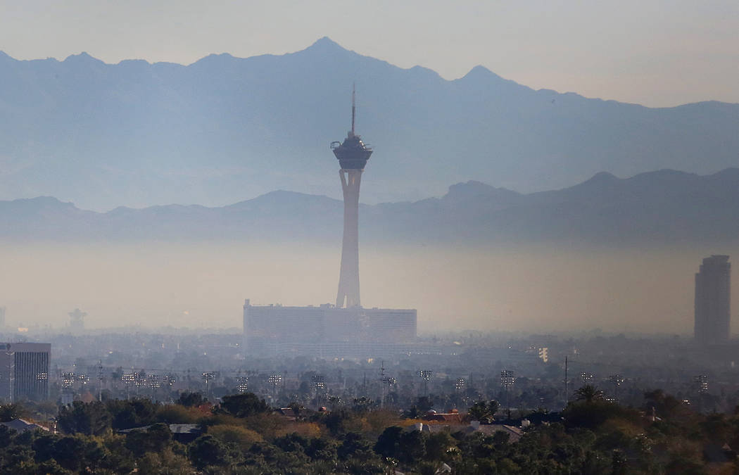 Haze hovers over the Stratosphere hotel-casino on Tuesday, Dec. 20, 2016, in Las Vegas. The valley will be sunny with highs in the upper 50s during the week and a chance for rain is expected durin ...