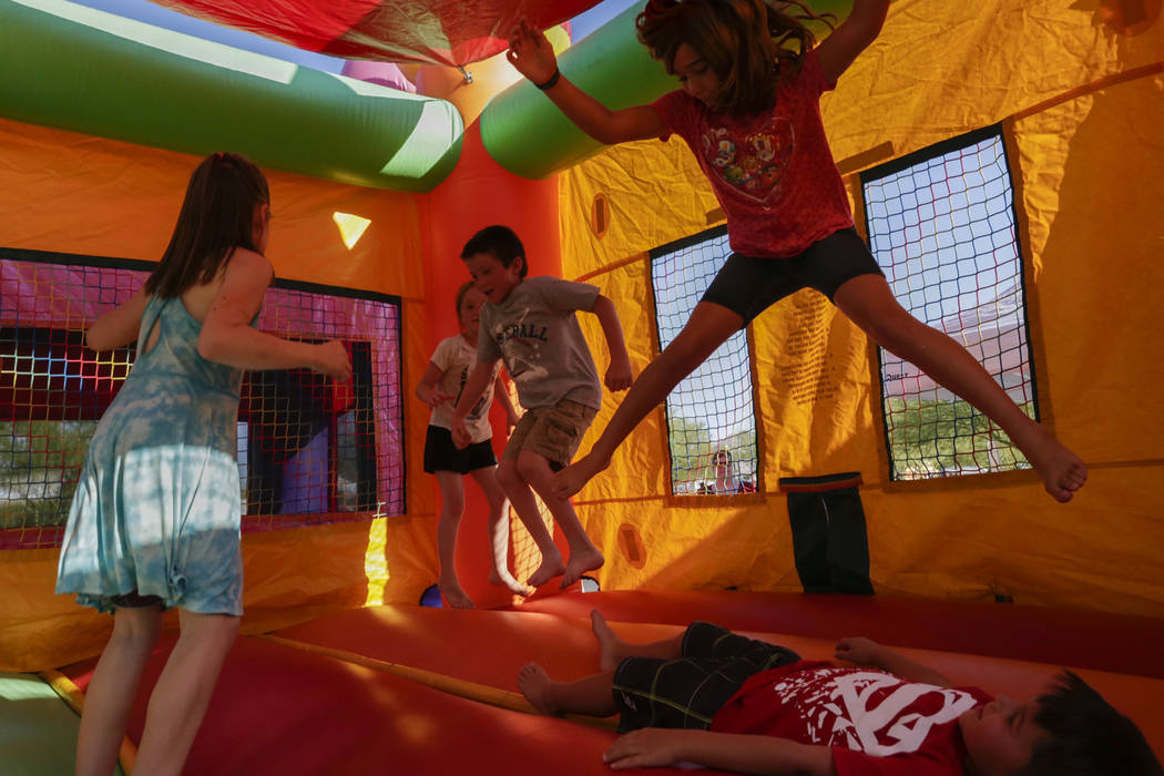 Kids jump around inside a bounce house at the City of Henderson's Fourth of July celebration at Heritage Park in Henderson, Tuesday, July 4, 2017. (Gabriella Angotti-Jones/Las Vegas Review-Journal ...