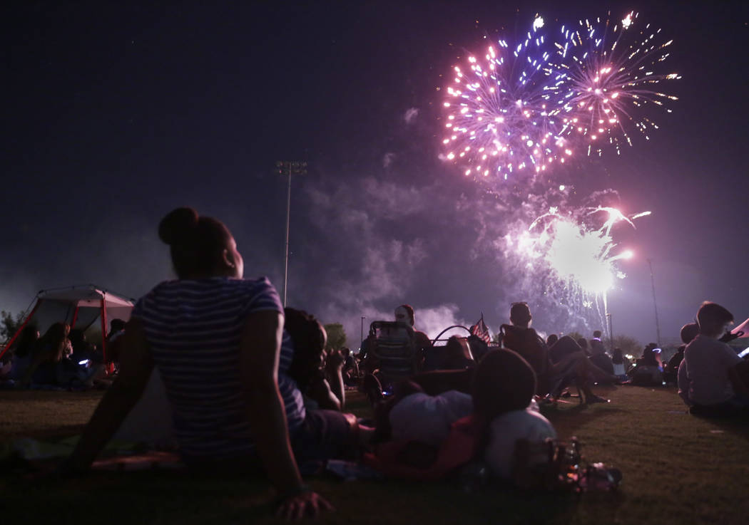 People enjoy the fireworks show at the City of Henderson's Fourth of July celebration at Heritage Park in Henderson, Tuesday, July 4, 2017. (Gabriella Angotti-Jones/Las Vegas Review-Journal) @gabr ...