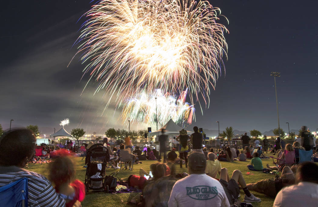 People watch fireworks explode during Fourth of July festivities at Heritage Park on Tuesday, July 4, 2017, in Henderson. Richard Brian Las Vegas Review-Journal