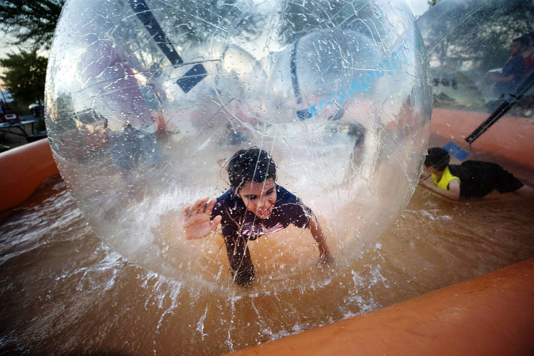 Youngsters play in the inflatable water bubble game during Fourth of July festivities at Heritage Park on Tuesday, July 4, 2017 in Henderson. Richard Brian Las Vegas Review-Journal