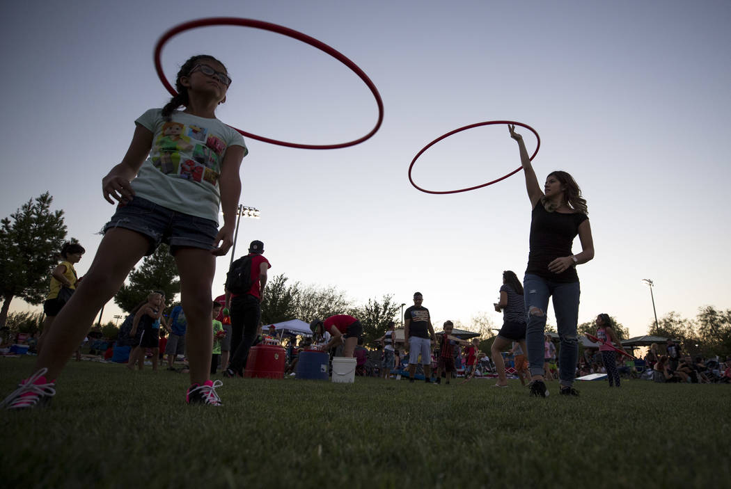 Brianna Hernandez, right, hula hoops with her 9-year-old daughter Julisa during Fourth of July festivities at Heritage Park on Tuesday, July 4, 2017 in Henderson. Richard Brian Las Vegas Review-Jo ...