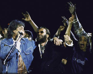 Las Vegas singer Michelle Johnson, far right, is shown singing with Paul McCartney and Ringo Starr at an Earth Day concert at Hollywood Bowl in Los Angeles on April 16, 1993. (Michelle Johnson)