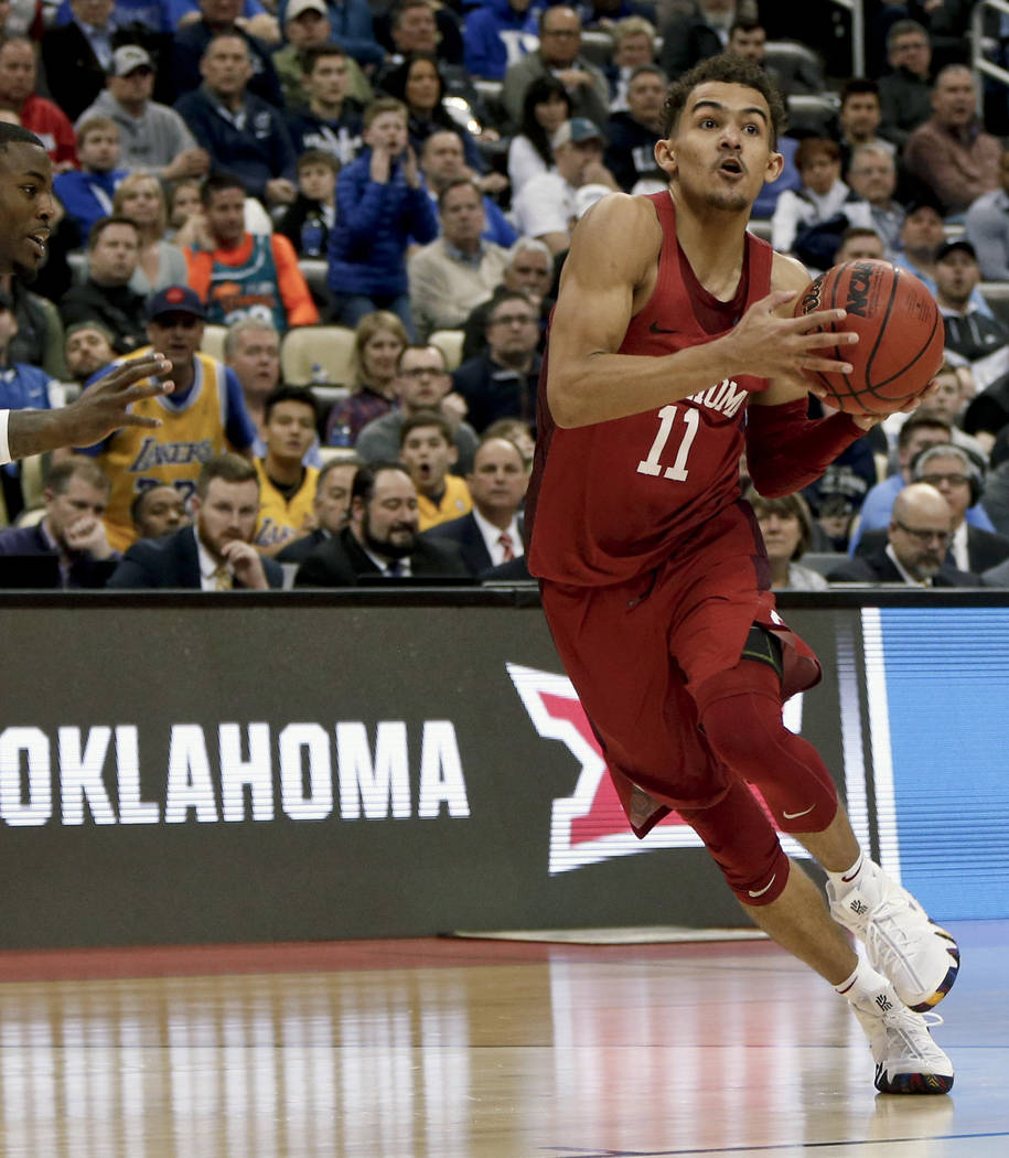 In this March 15, 2018, file photo, Oklahoma's Trae Young drives to the hoop during overtime of an NCAA men's college basketball tournament first-round game against Rhode Island,in Pittsburgh. (AP ...